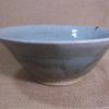 Bowl.  With poured celadon and speckled white glaze..