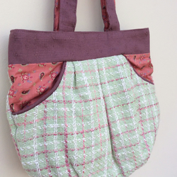 Green and pink tweed style handbag