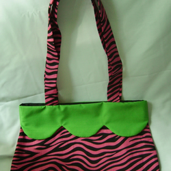Neon pink and green tiger print hand bag