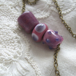 Necklace of Lampworked Pink and Purple Harvest Beads