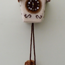 Knitted cuckoo clock, chocolate colours
