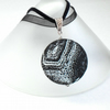 Black & white monochrome fossil agate coin pendant, on ribbon and suede hanging