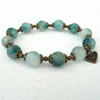 Handmade teal green jade and bronze bracelet with heart charm embellishment