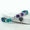 Dainty green and purple stretchy bracelet with heart charm embellishment