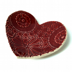 Ruby lace heart dish in stoneware ceramic with deep red glaze