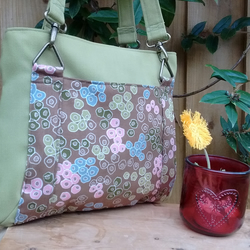 Lime green and brown spotty print fabric handbag with three pockets and key clip