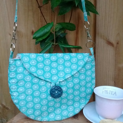 Blue-green abstract flower print bag with button fastening and inner pocket