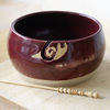Pottery yarn bowl - stoneware bowl glazed in ruby red with snail curl for your wool