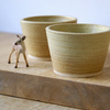 Two stoneware pottery beaker cups - glazed in natural brown