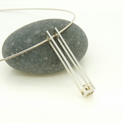 Elegant 'Rolling' Pendant in Sterling Silver with 9ct Gold