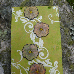 Green Canvas Wallhanging with Flowers and Embossed White Swirl