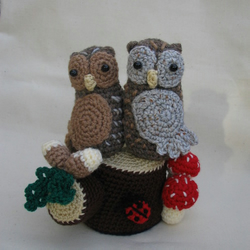 Pair of  Owls Sitting on a Log