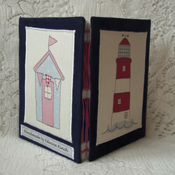 Notebook with lighthouse
