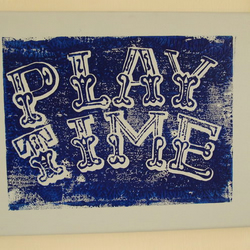 """Playtime"" linocut on blue canvas"