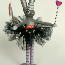 Butcher bunny with purple tights, machete and wand.