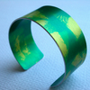 Green and gold cuff