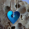 Blue and turquoise heart with flowers