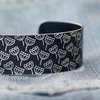 Black aluminium cuff - seed head pattern