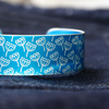 Blue aluminium cuff with seed head pattern