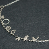 Birds and leaves necklace