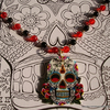 Mexican day of the dead skull and rosary bead necklace