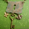 Steampunk key and insect necklace