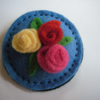 Pale blue Circle Brooch with rolled flower Trio