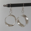Silver anticlastic hoop earrings Argentium ear wires lots of movement