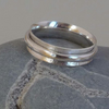 Sterling Silver Spinner ring with hammered outer ring forged and patterned
