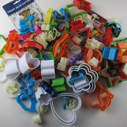 Over 100 Plastic Cutters Mixed Shapes as shown Animals Hearts Stars Bears