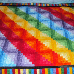 Rainbow log cabin quilt