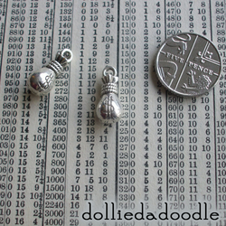 5 silver coloured money bag charms