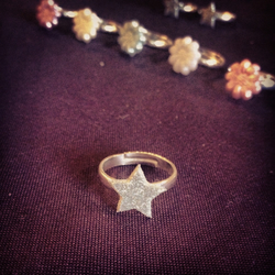 Tiny silver glitter star ring