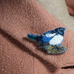 Hand embroidered textile magpie brooch