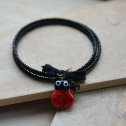 Handmade Black Memory Wire Bracelet with Red Black Lampwork Glass Ladybird Bead