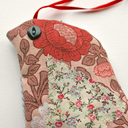 Bird organic lavender shaped animal pillow, recycled patterned fabric.