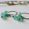 Opaque turquoise flower earrings