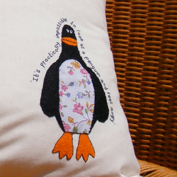 Appliqued penguin cushion pillow cover made from organic cream cotton