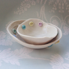 Handmade porcelain trinket dish set of two, button detail.