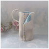 Handmade porcelain opening button wonky jug. Discounted