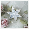 Porcelain hanging snow flake decoration. Christmas.