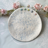 Handmade porcelain decorative plate with button detail