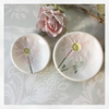 Two porcelain trinket dishes with flower detail. Gift boxed.