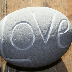 LOVE hand carved large pebble