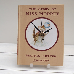 Miss Moppet beige book clock made from the Beatrix Potter tale of the kitten