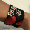 Small wrist cuff, black with red and cream flowers