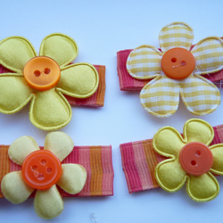 Orange flower hair clips