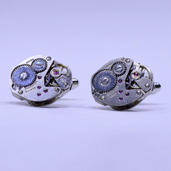 Cufflinks with mechanical watches attached 154