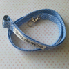 lanyard handmade out of blue and white polka dot cotton with safety clip