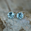 Sterling Silver Stud Earrings with Sky Blue Topaz Faceted Gemstones, E131